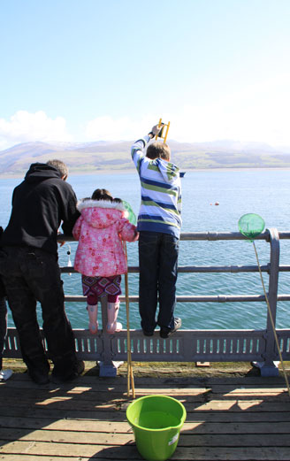 children crabbing in holiday in north Wales